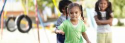 Children interact on a playground.
