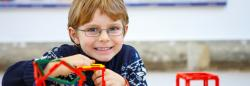 Young boy playing with plastic cubes