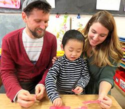 Coteachers working with child.