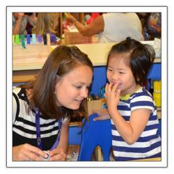 Teacher listening to a child's story
