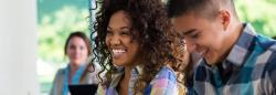 Two people setting in a class.