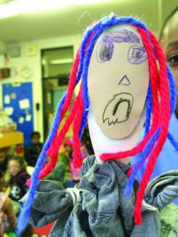 Children create peace puppets to support their developing social and emotional skills