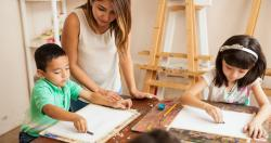 Children drawing in an art studio