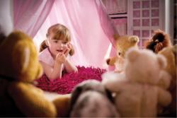 Child and her stuffed animals