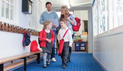 Family walking down school hallway.