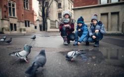 Teacher and two students observing pigeons