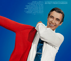 Mr. Rogers putting on a sweater