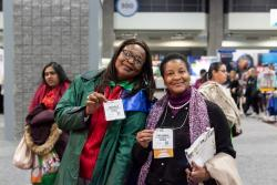 Two women pose for a picture at NAEYC's Annual Conference