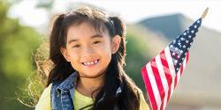 Preschool aged girl holding an American flag