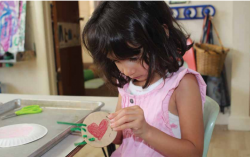 Girl creating meaningful art piece
