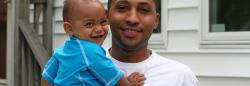 Father and baby boy smiling