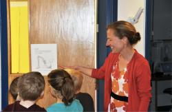 Teacher showing students an illustration