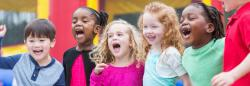 Diverse group of children playing outdoors