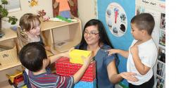 Margarita Barragan in a classroom with three preschoolers