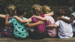 Group of children hugging each other