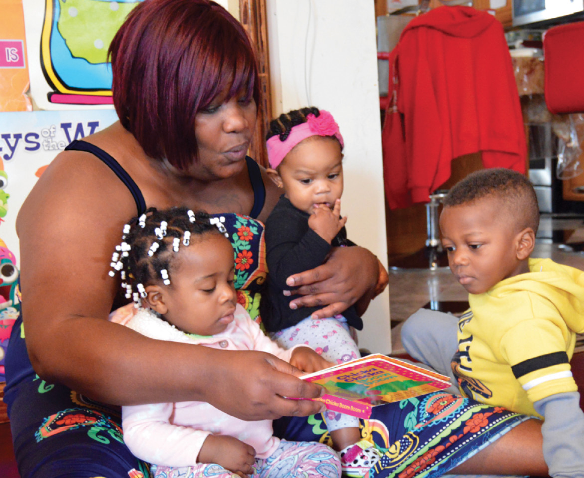 Shirnet Fray Palmer, teacher reading with her students